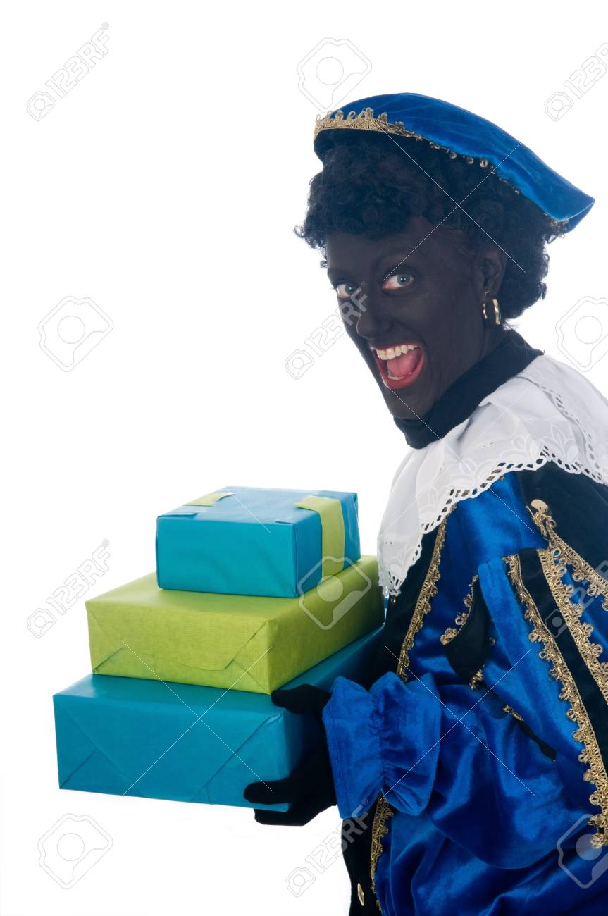 Zwarte Piet is a Dutch tradition during Sinterklaas, which is celebrated in December the fifth. Stock Photo - 13218628