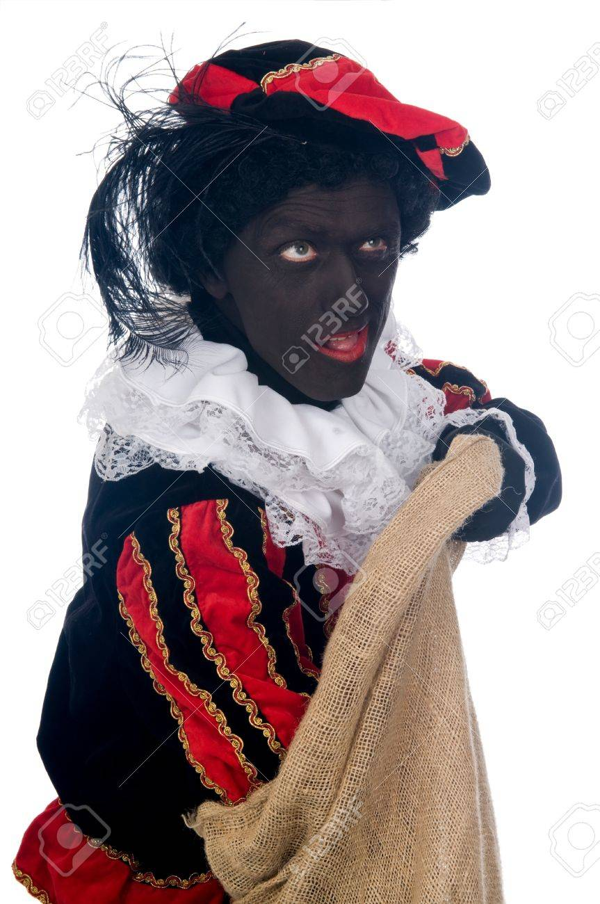 Zwarte Piet is a Dutch tradition during Sinterklaas, which is celebrated in December the fifth. Stock Photo - 13218664