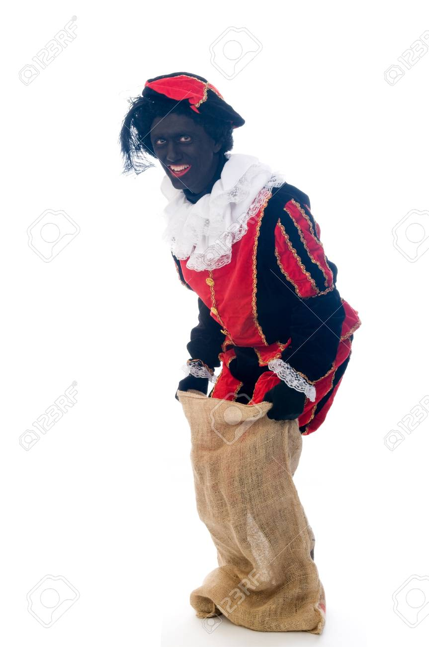 Zwarte Piet is a Dutch tradition during Sinterklaas, which is celebrated in December the fifth. Stock Photo - 13218622