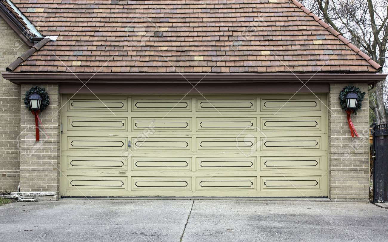 Traditional two car wooden garage with decoration Stock Photo - 17326853
