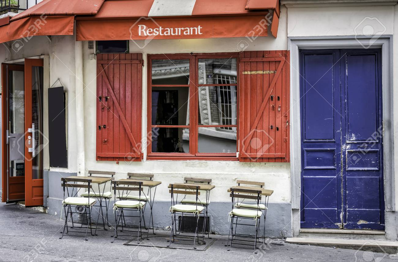 French Restaurant With Tables And Chairs On The Street Of Paris
