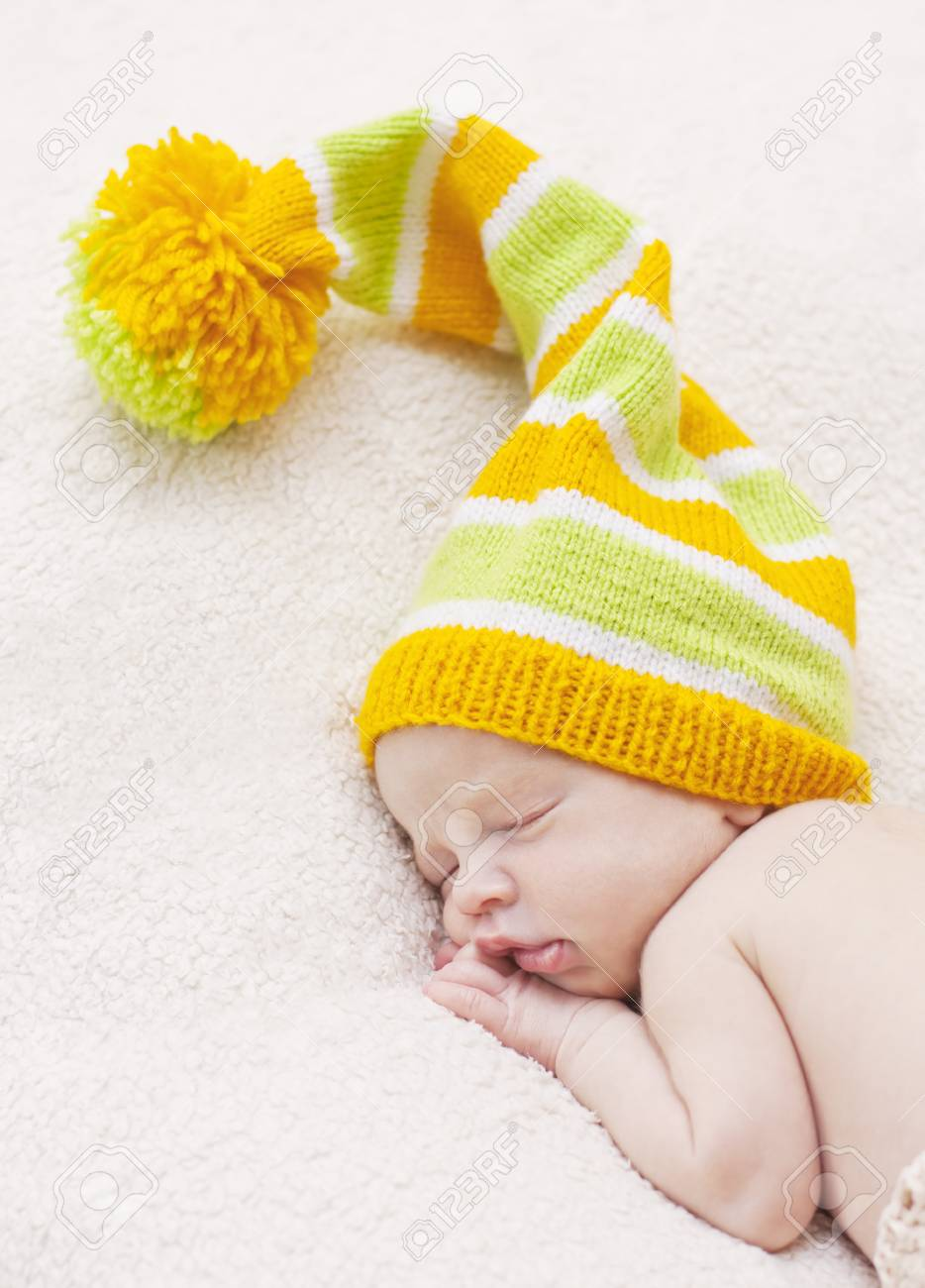 Close-up sleeping newbornon a white background with bright hat Stock Photo - 22578963