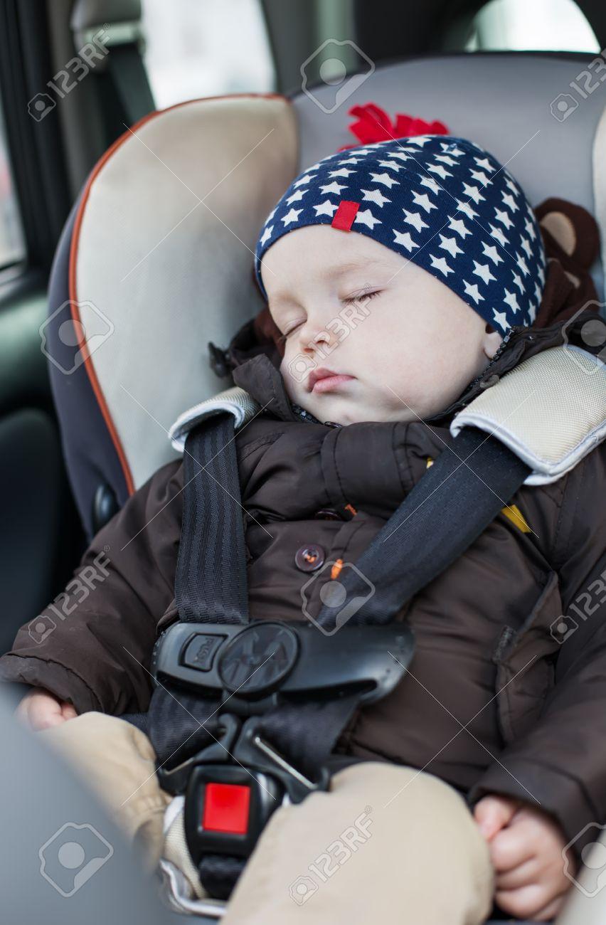 Cute Baby Boy Sleeping In Car Seat Stock Photo