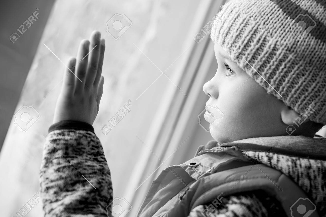 Cute Sad Little Boy Looking Out The Window Black And White Stock Photo Picture And Royalty Free Image Image 36753000
