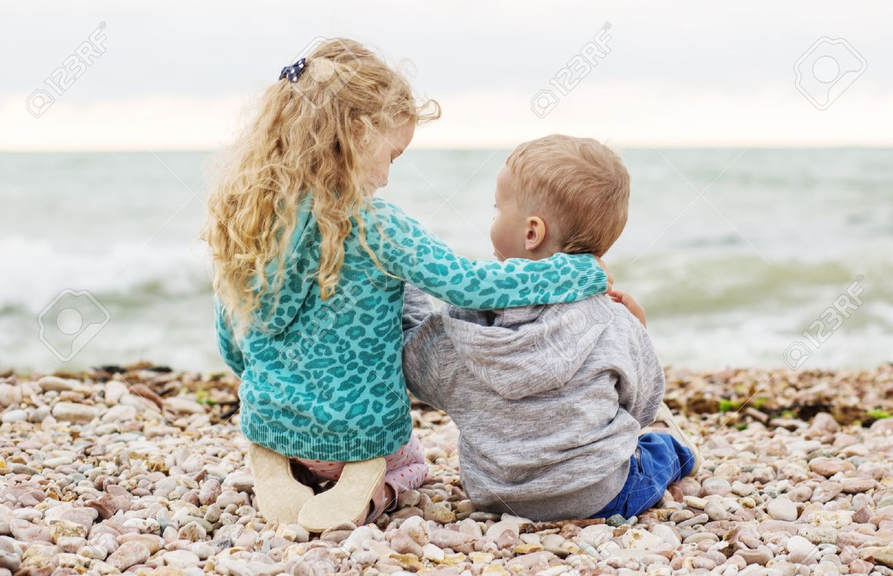 Cute Little Brother And Sister Playing On The Beach Stock Photo