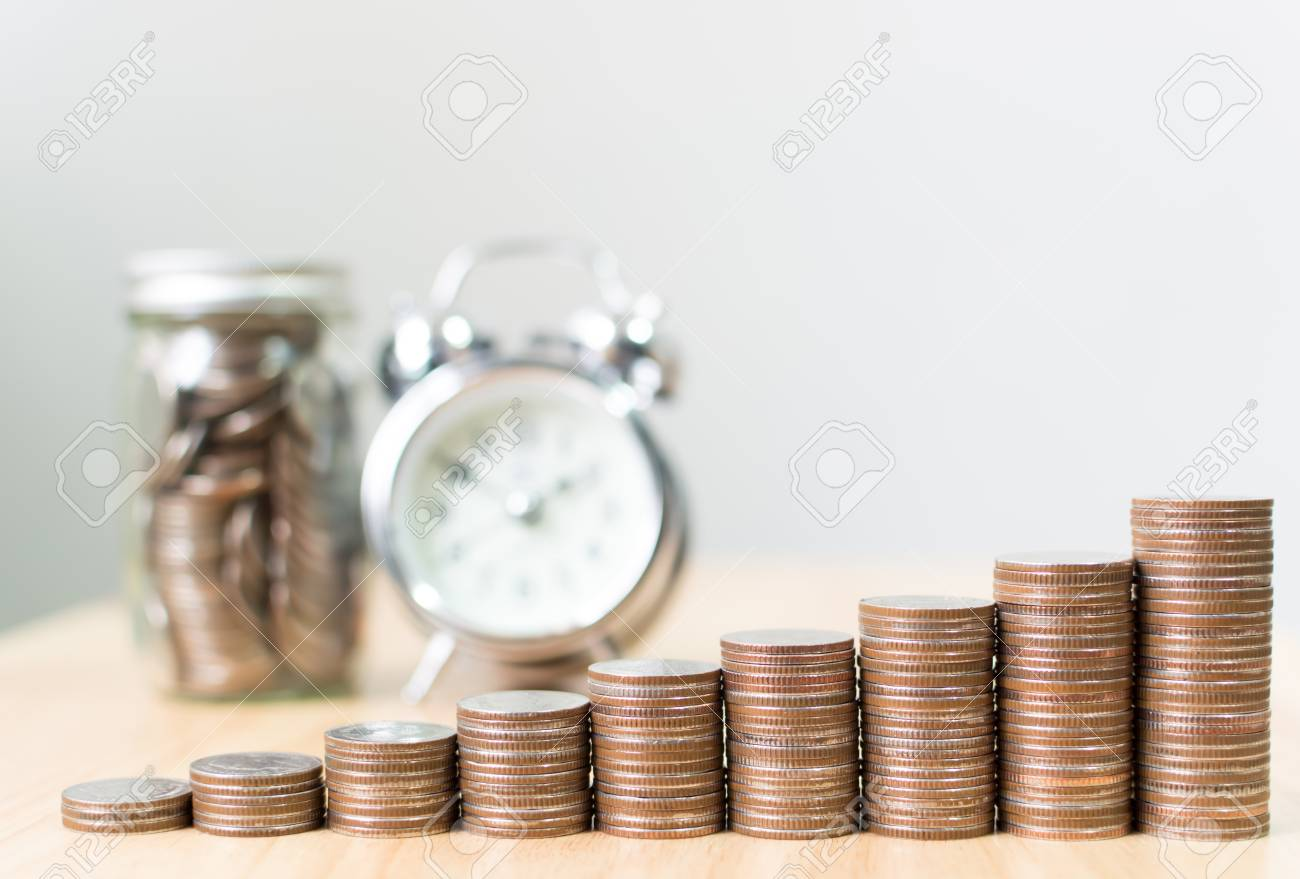 Coin stack step growing up to success financial business with clock and jar, Save money and investment concept, Copy space for your text - 93524415