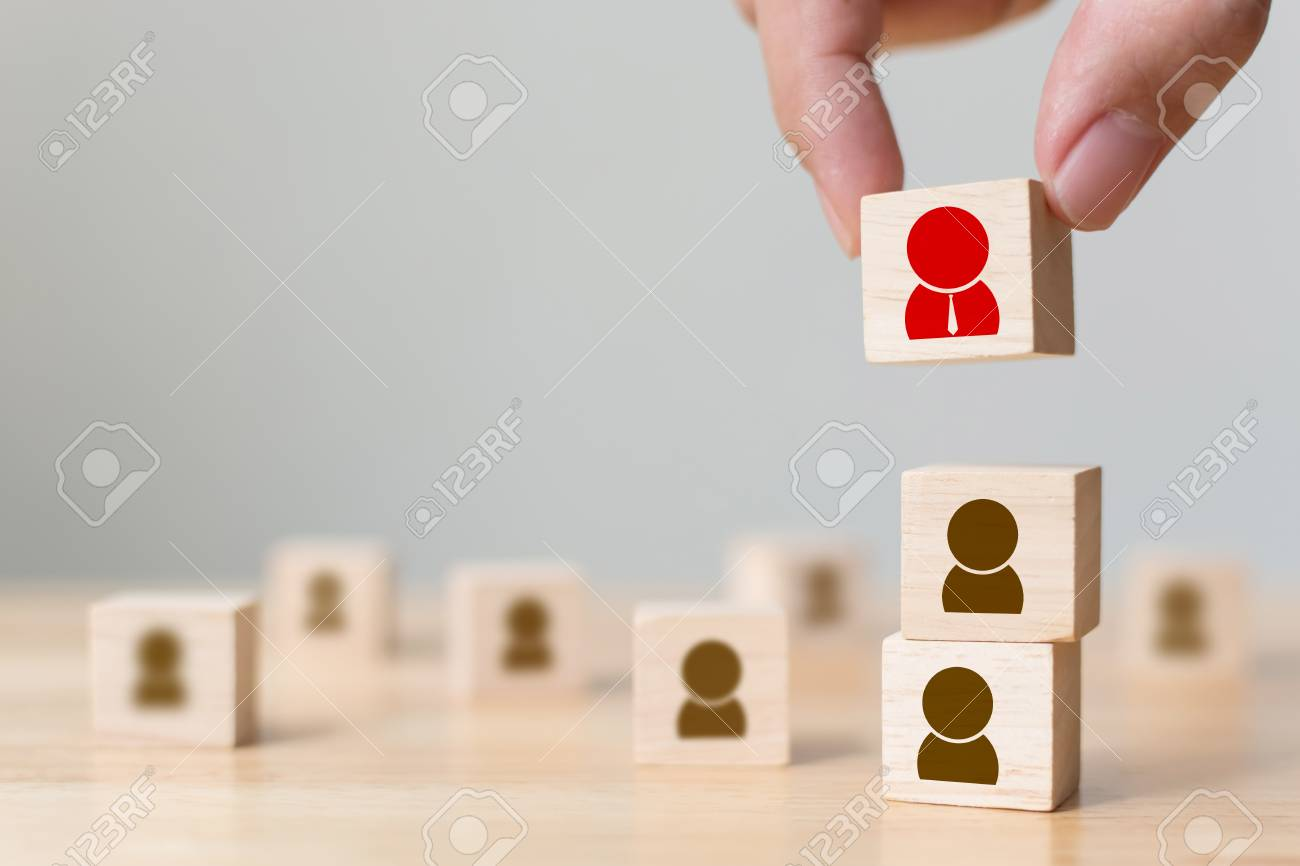 Human resource management and recruitment business build team concept, Hand putting wood cube block on top, Copy space - 96382443