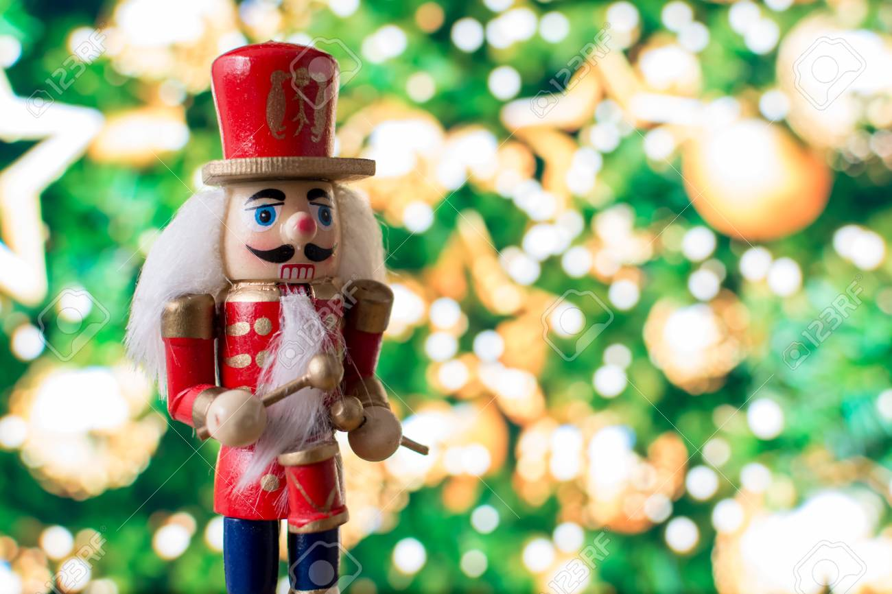 Christmas nutcracker toy soldier traditional figurine with bokeh background - 105086661