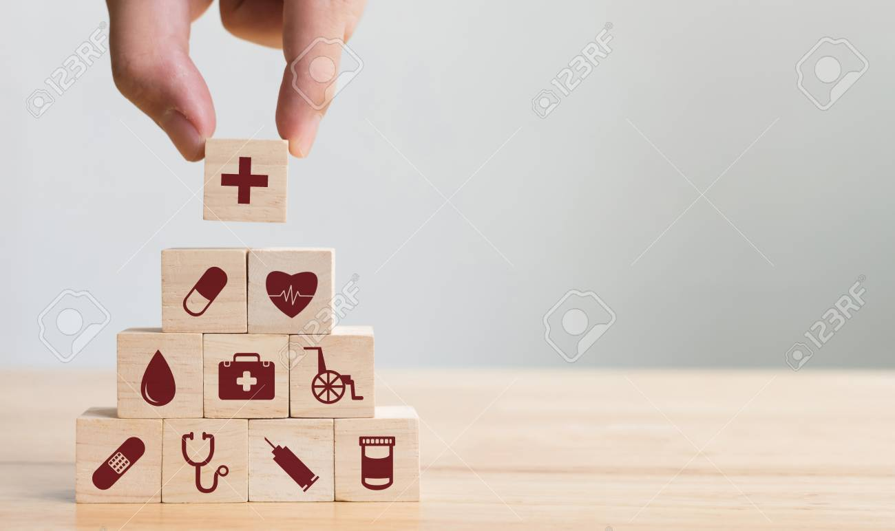 Hand arranging wood block stacking with icon healthcare medical, Insurance for your health concept - 102021931