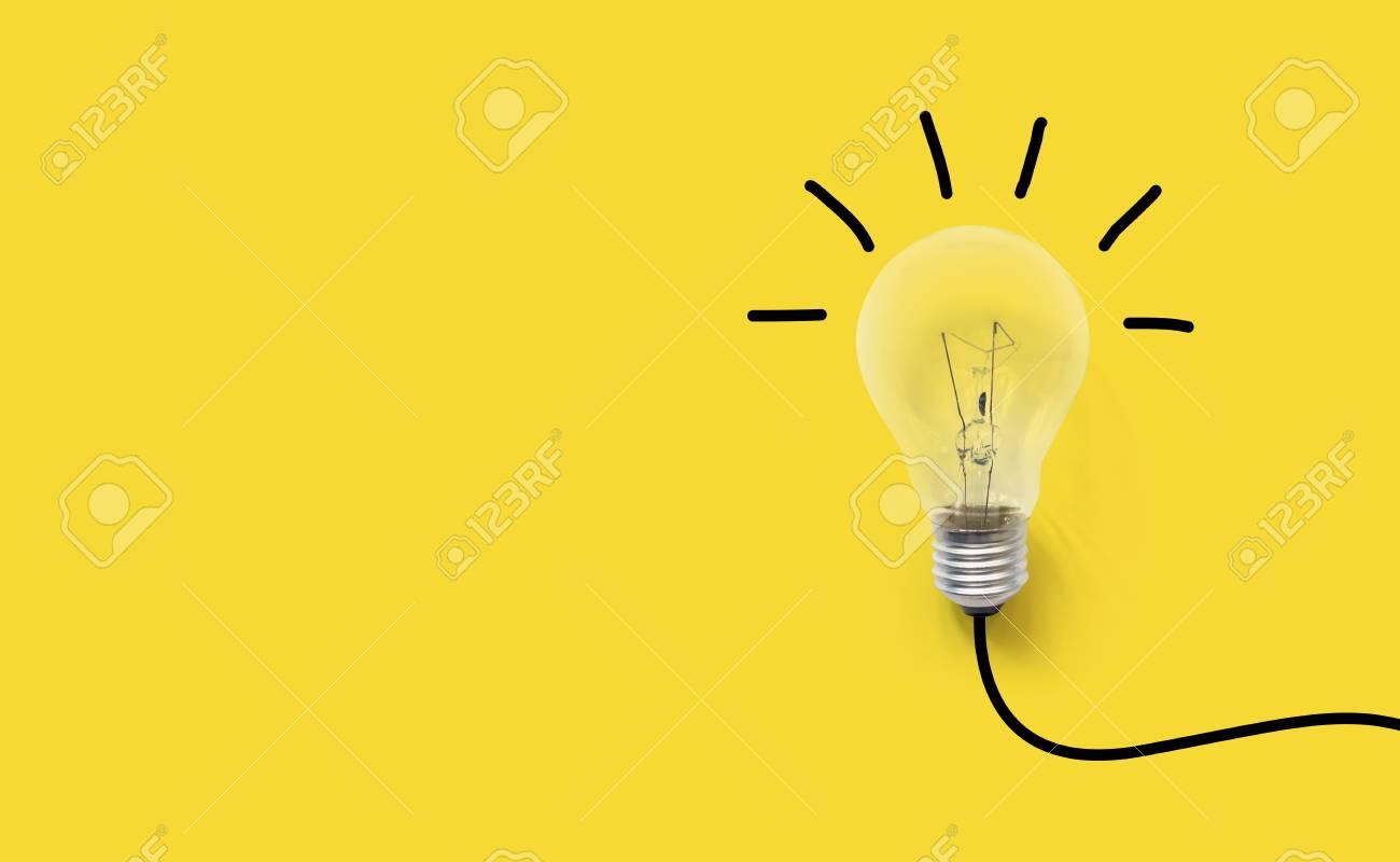 Creative thinking ideas brain innovation concept. Light bulb on yellow background - 105210804
