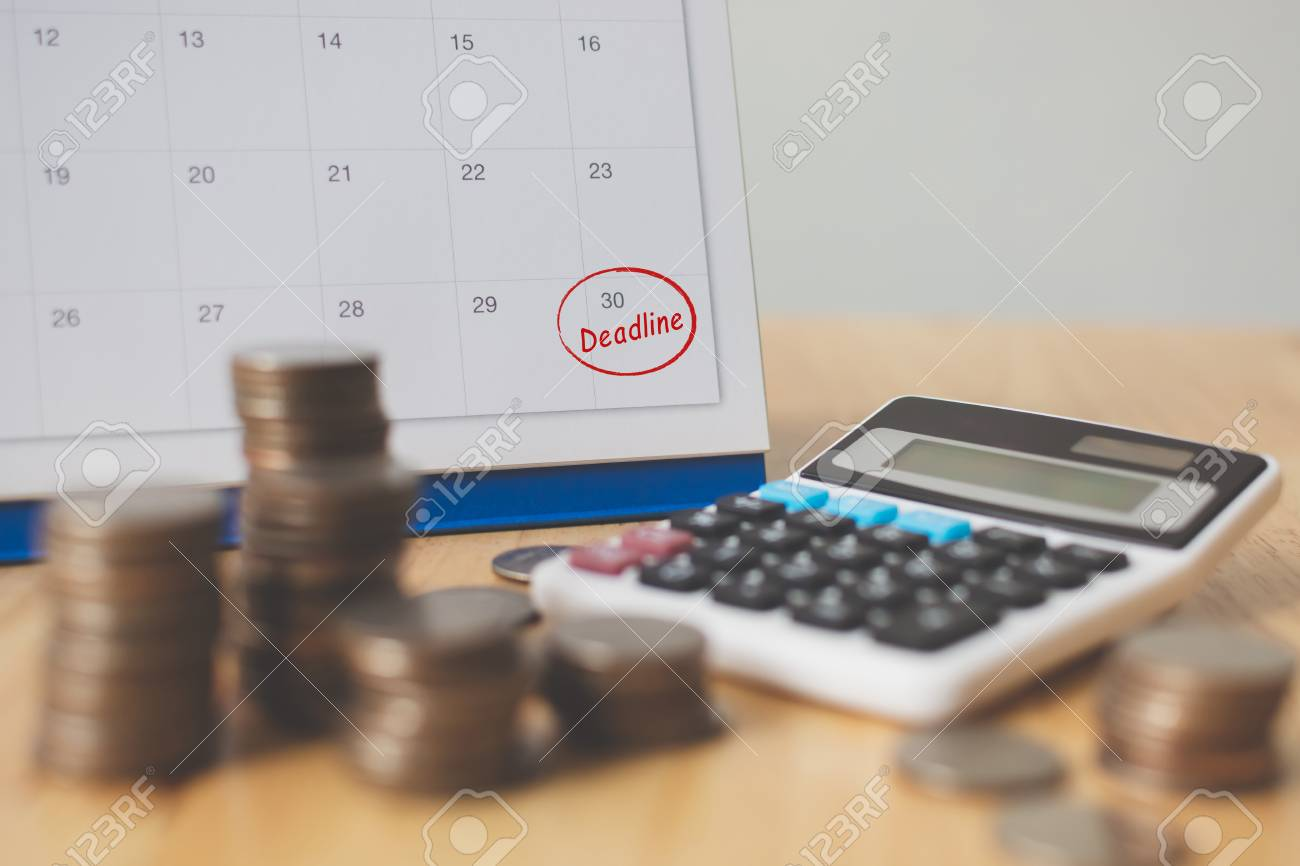 Tax payment season and finance debt collection deadline concept. Money coins stack, calendar and calculator - 105210941