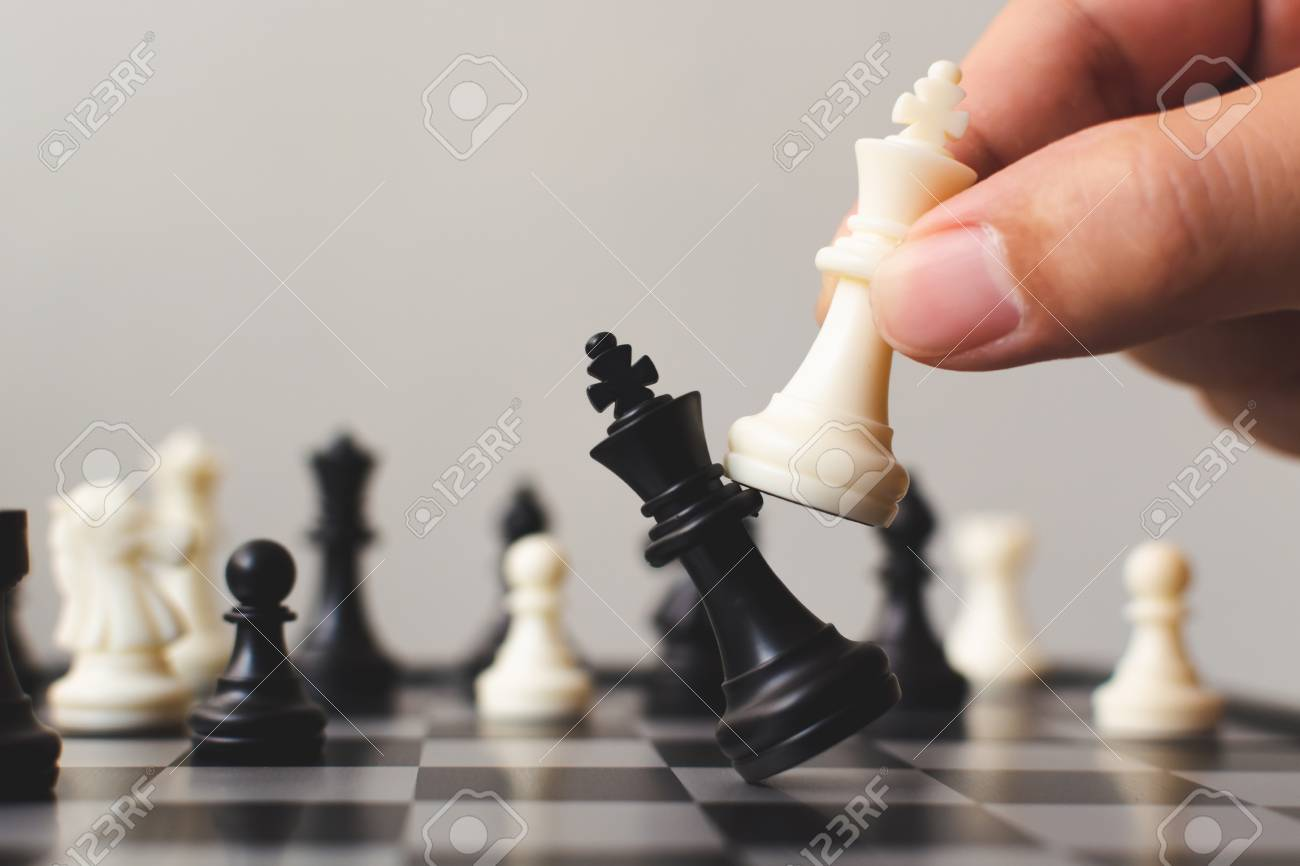 Plan leading strategy of successful business competition leader concept, Hand of player chess board game putting white pawn, Copy space for your text - 120893166