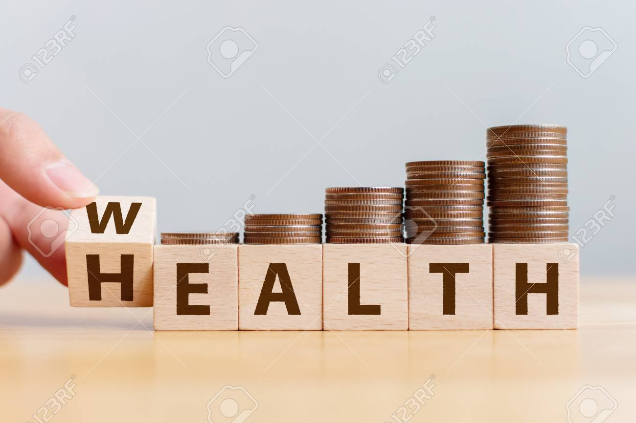 Hand flip wooden cube with word wealth to health with coins stack step up growing growth value. Investment in life insurance and healthcare concept - 126131581