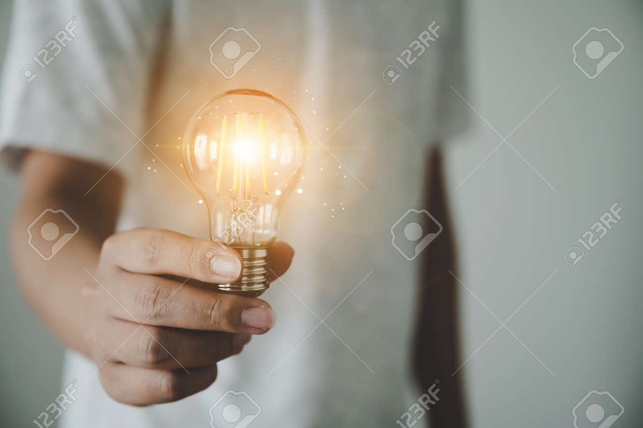 Hand of man holding light bulb. Concept of inspiration creative idea thinking and future technology innovation - 173439940