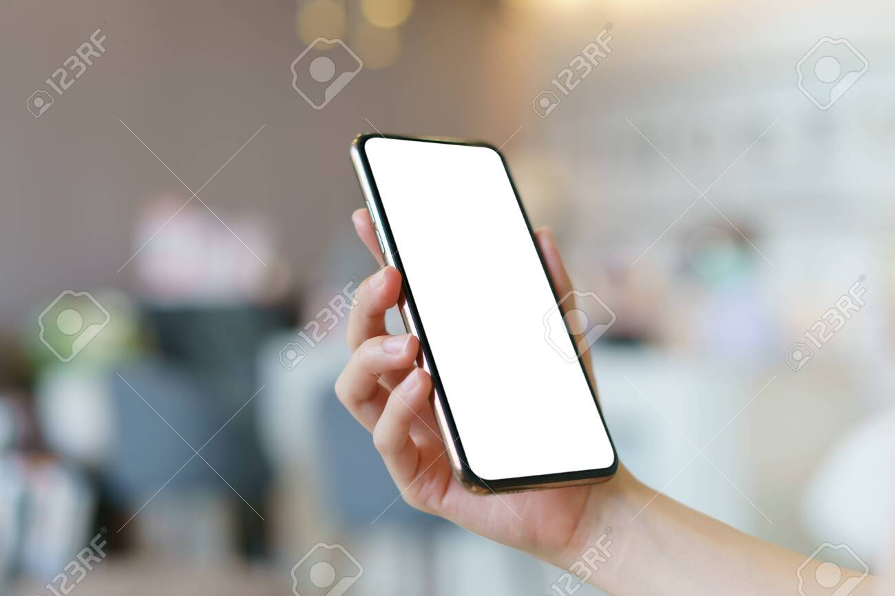 Mockup image of hand holding mobile phone with blank white screen. - 147878199