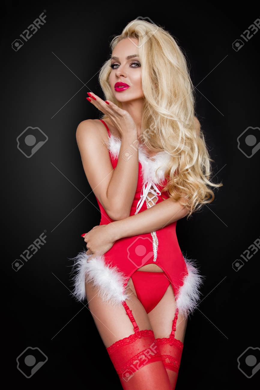 a3dd62220da Beautiful sexy blonde female model snowflake dressed as Santa Claus erotic  red lingerie with white fur
