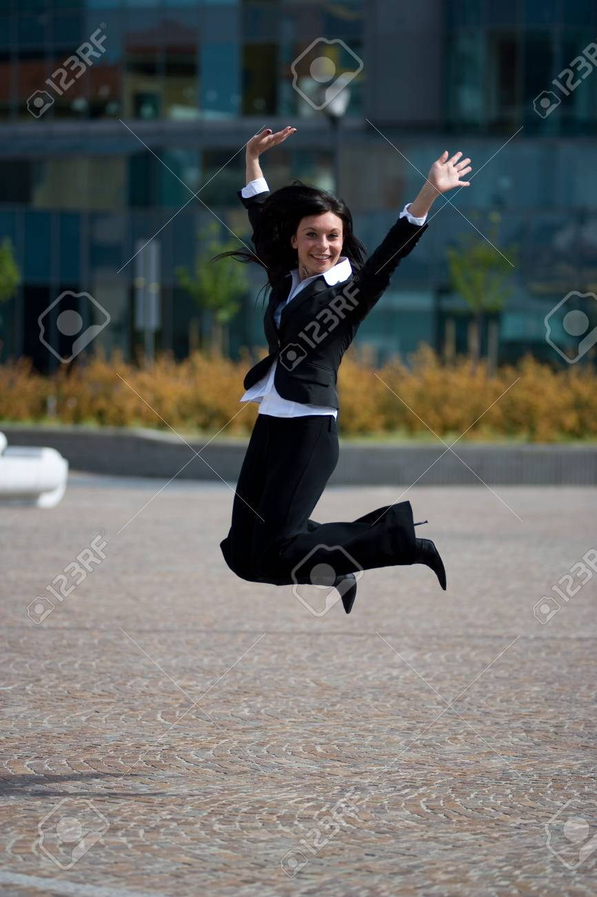 full figure with jump of a young adult businesswoman outdoors in a sunny day Stock Photo - 3012486