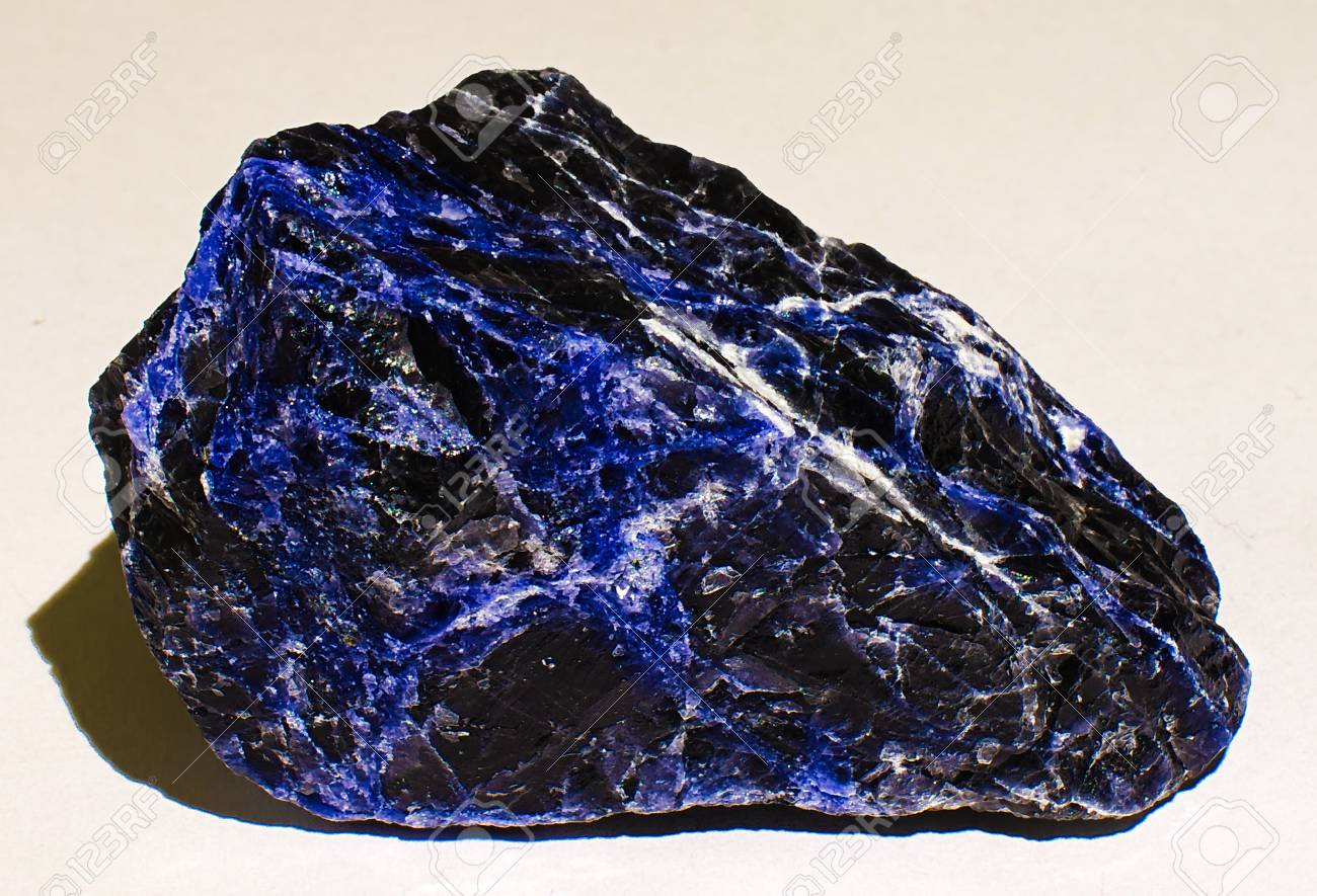 sodalite blue black veined mineral stone stock photo picture and