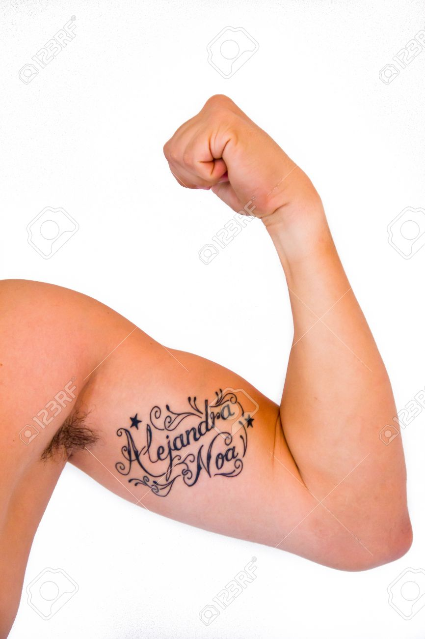 flexed arm with a tatoo Stock Photo - 16410819