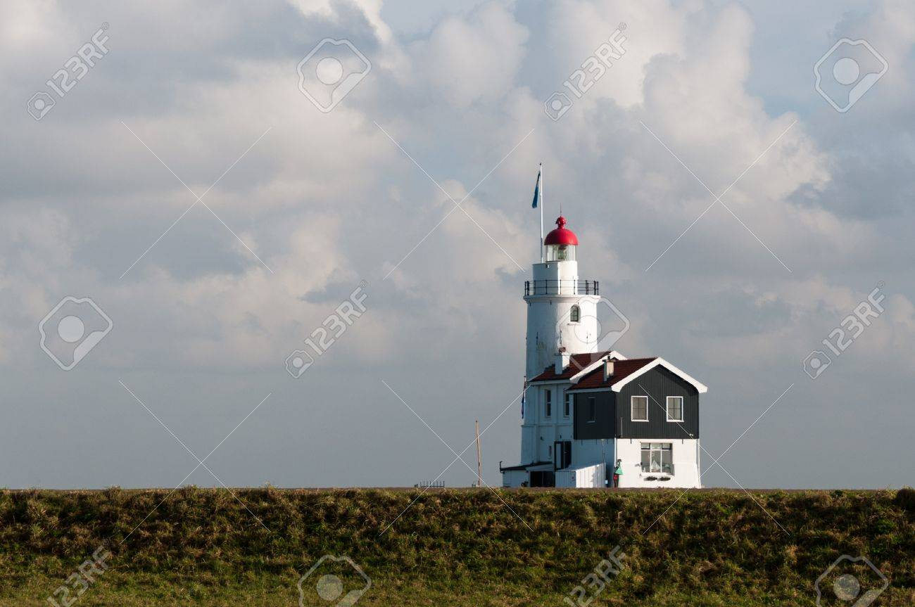 lighthouse behind the dike Stock Photo - 12677184