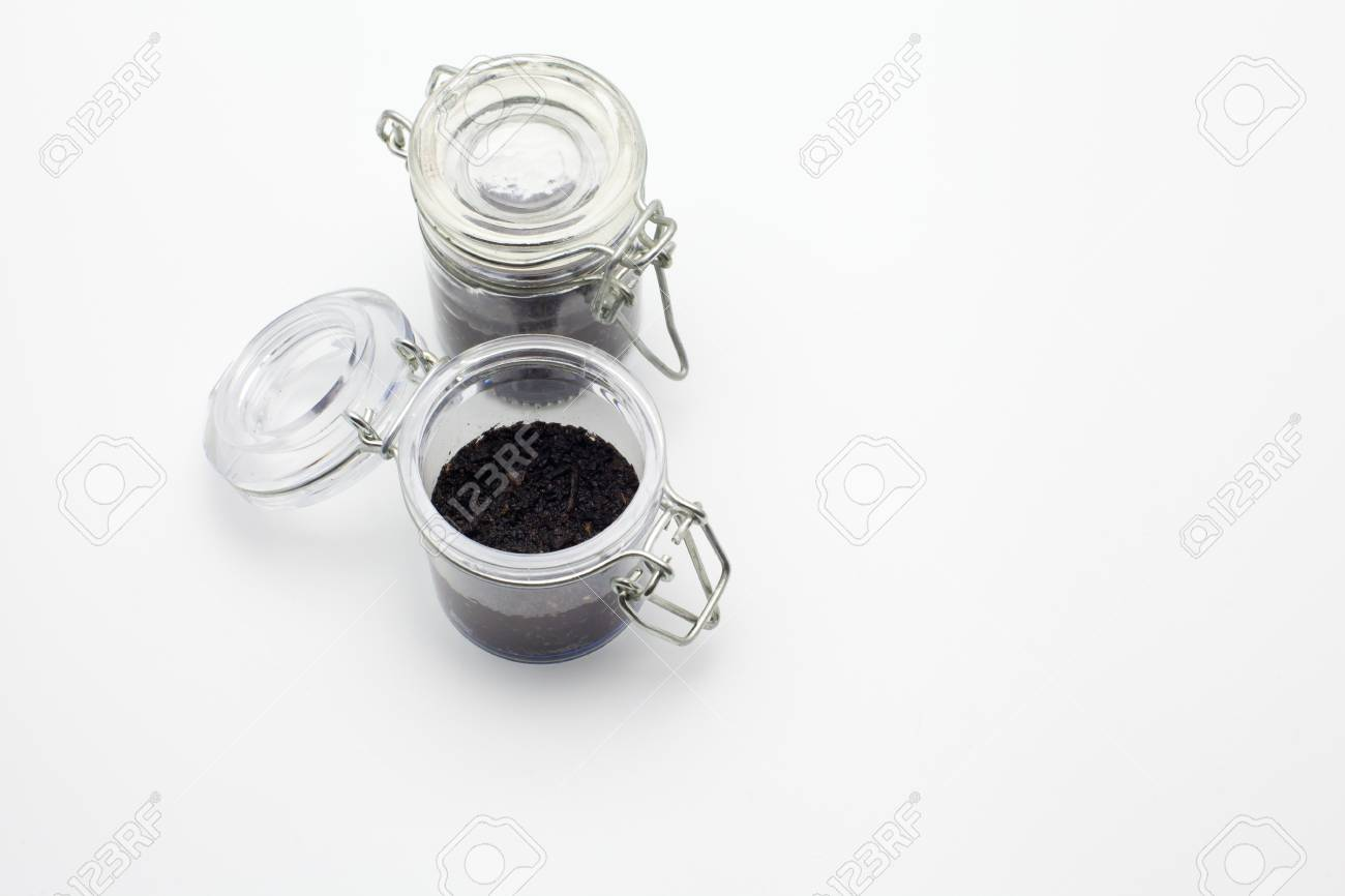 ecology concept little glass jar with soil stock photo picture and