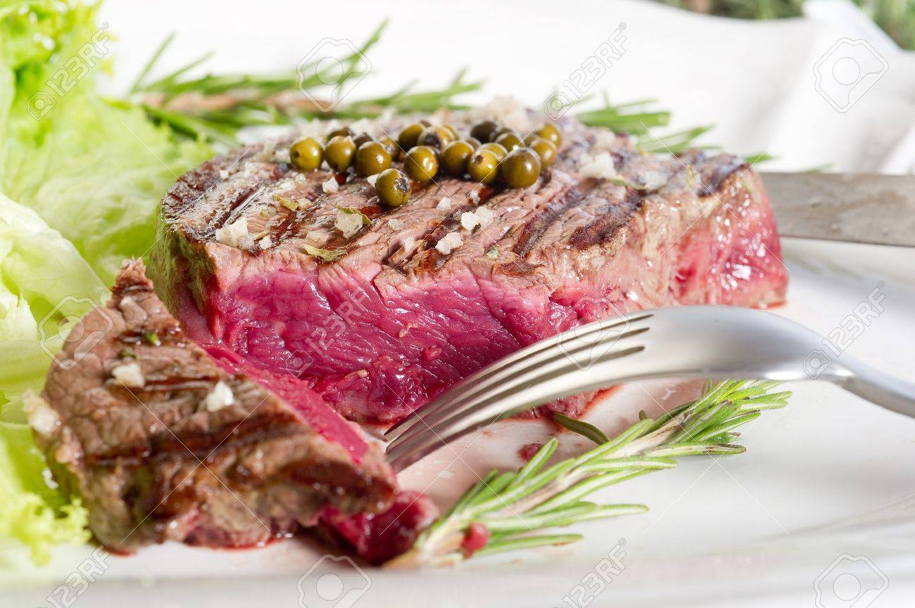 slice tenderloin with salad Stock Photo - 10426443