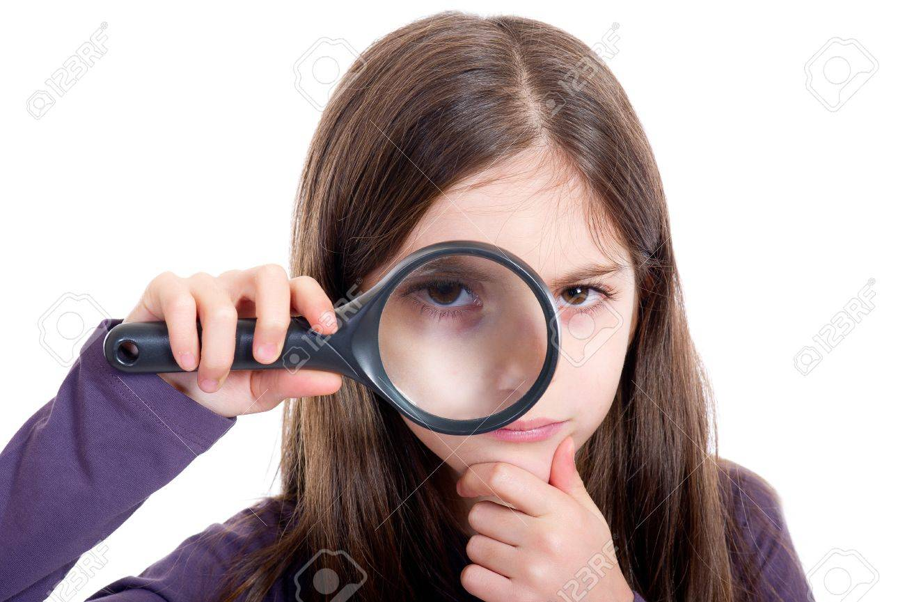 Girl holding magnifying glass Stock Photo - 11727790