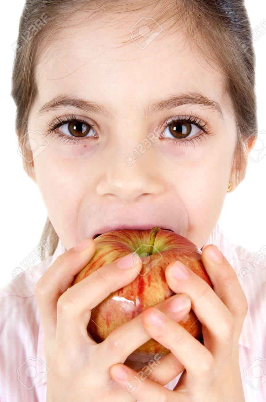 little girl eating apple Stock Photo - 11735824