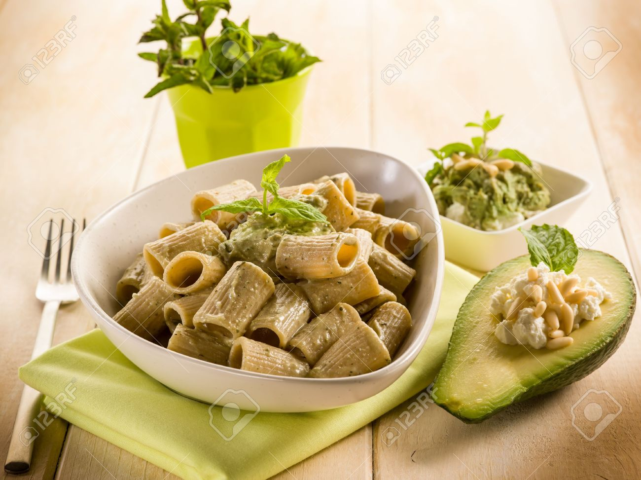 Pasta With Avocado Mint And Pine Nuts Pesto Stock Photo, Picture