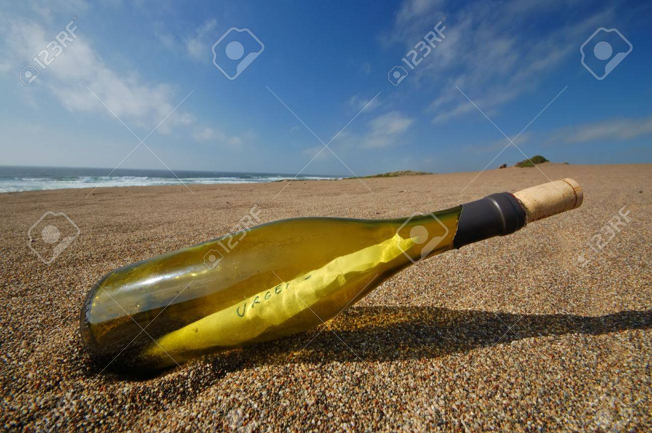 bottle with a message in it on the beach Stock Photo - 398542