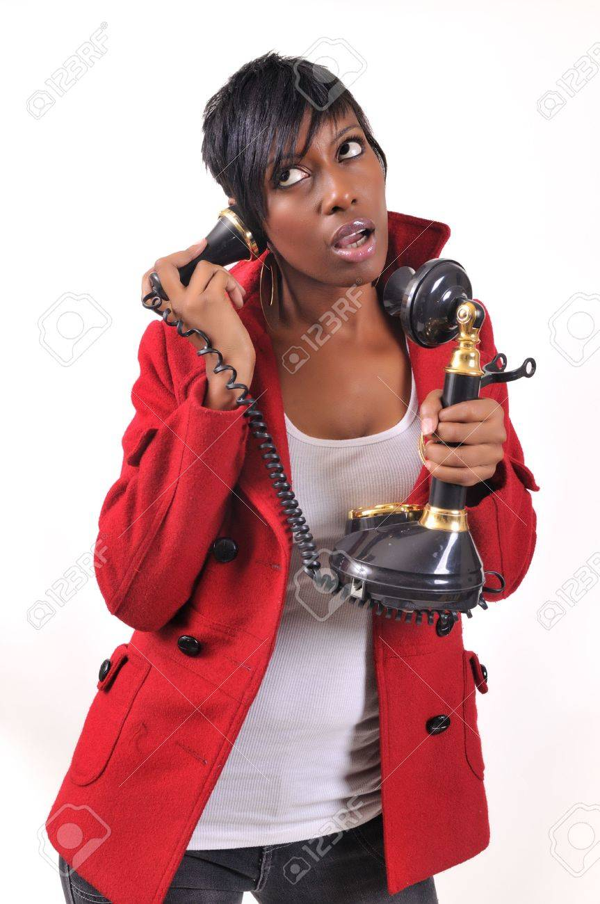Pretty African American lady talking on the phone, looking annoyed Stock Photo - 4184496