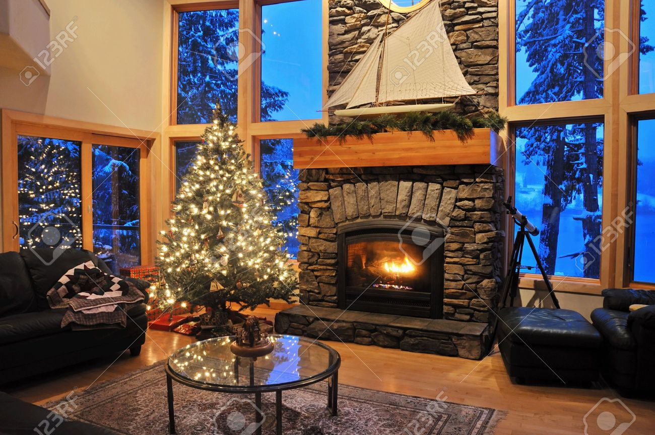 livingroom of an upscale house in winter with a fire in the