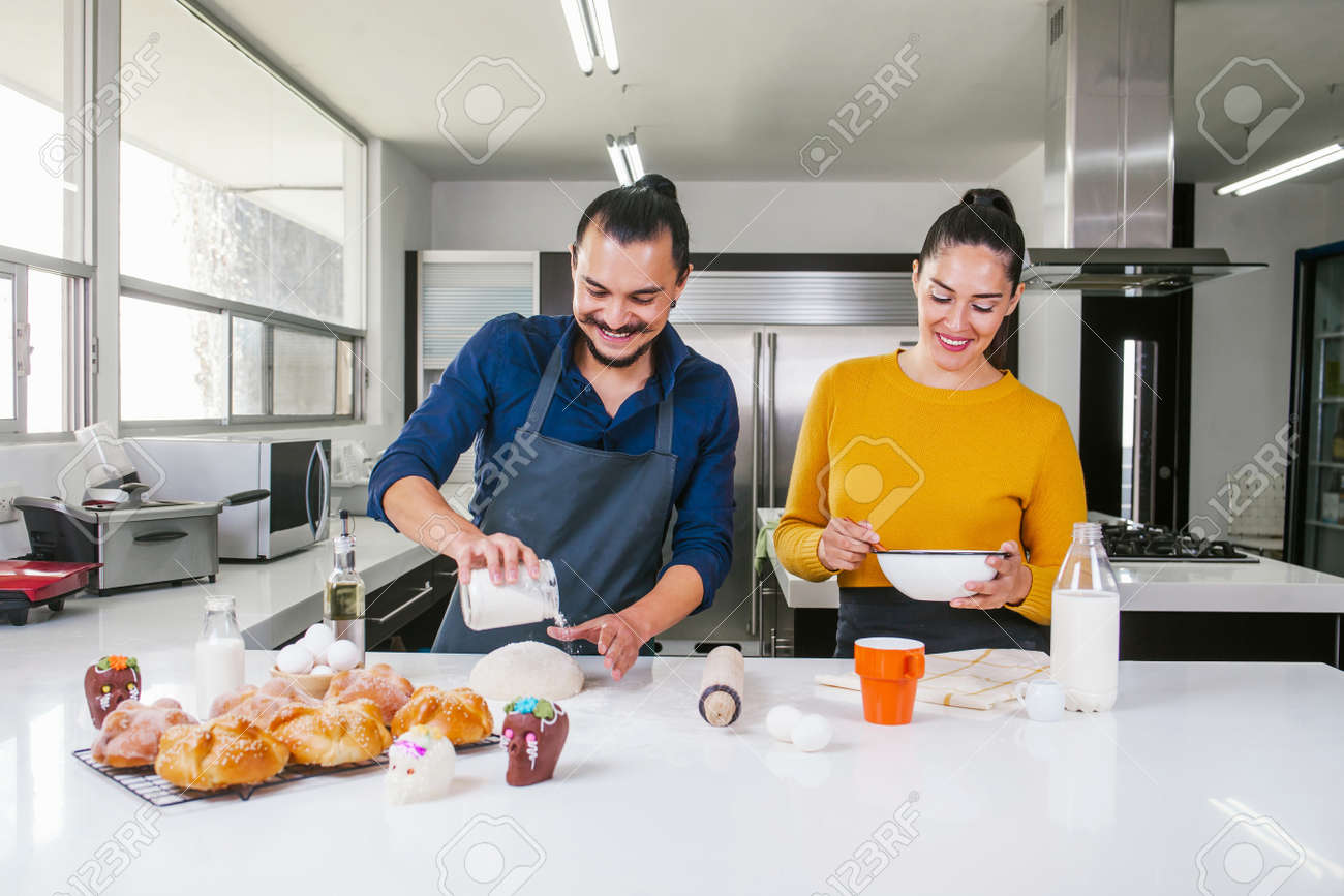 Mexican man baking bread called pan de muerto traditional from Mexico in Halloween - 156842126