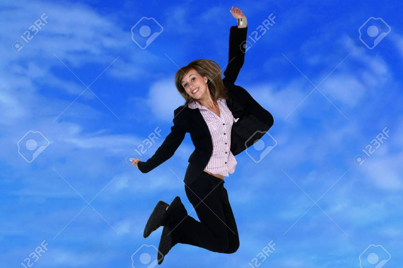 Businesswoman jumping on sky background Stock Photo - 3208381