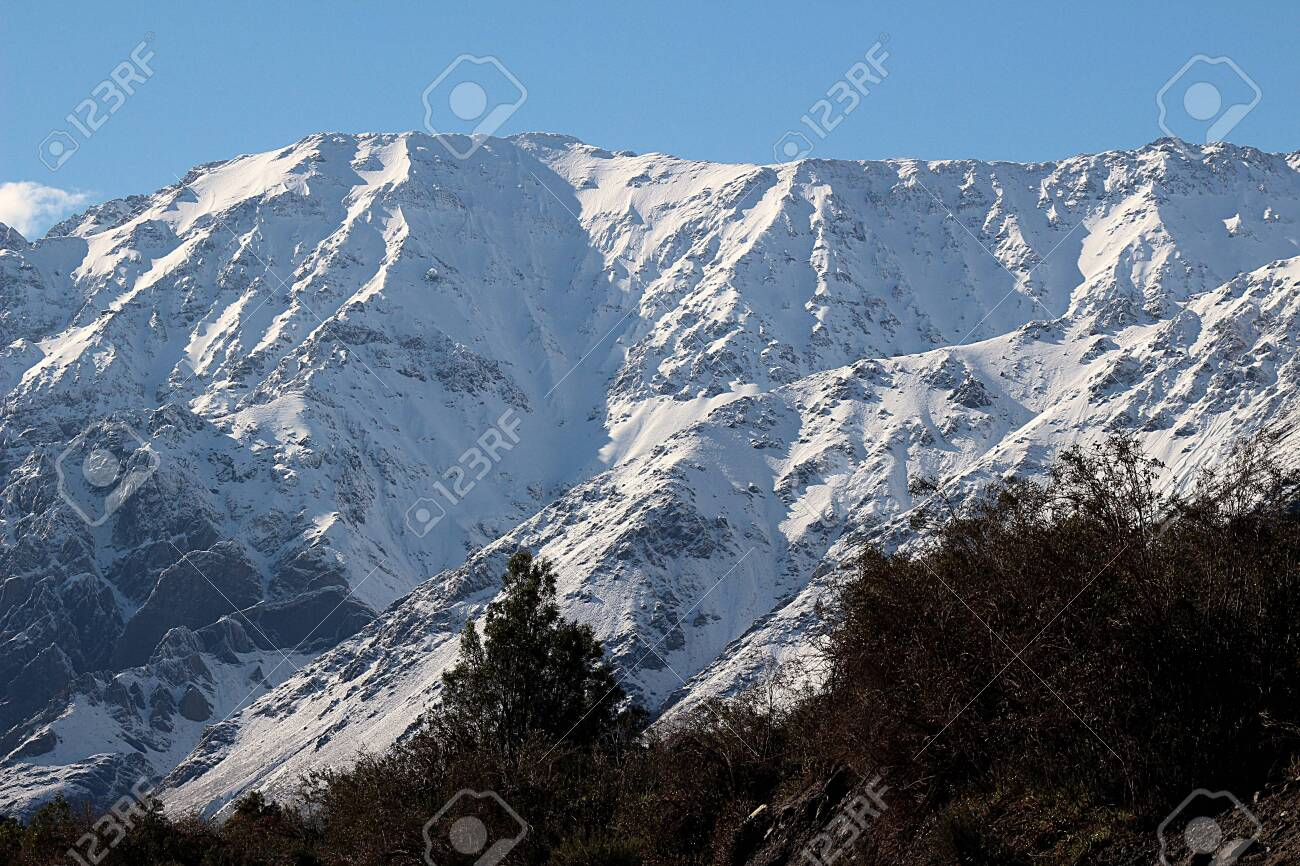 High peaks of snowy mountains on winter in Cajón del Maipo, in the central Andes of Chile. - 135224863