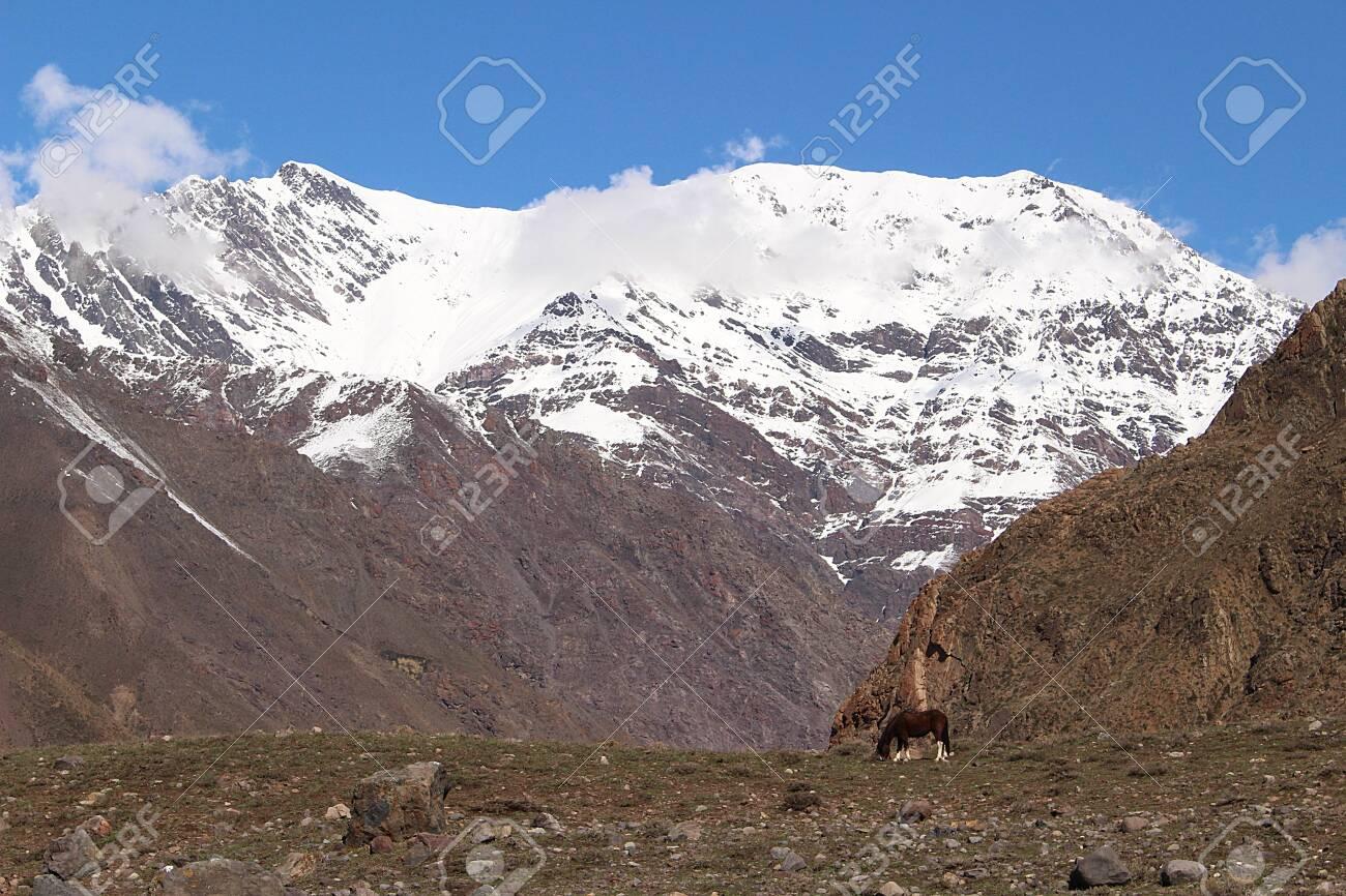 High peaks of snowy mountains on winter in Cajón del Maipo, in the central Andes of Chile. - 135521770