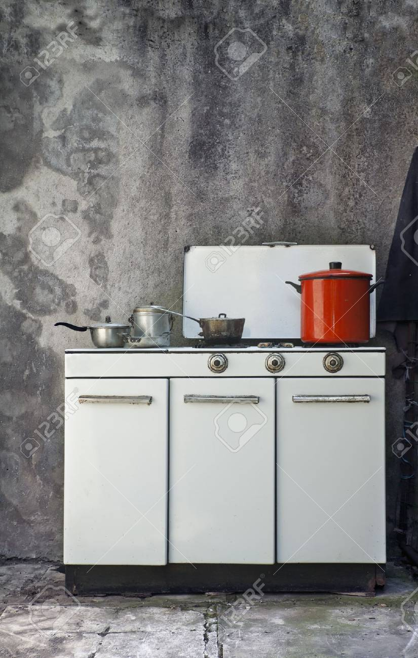 Kitchen Wall Background old gas stove over a grunge wall background stock photo, picture