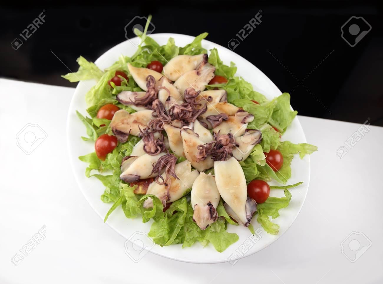 Close up of grilled calamari and green salad Stock Photo - 14254582