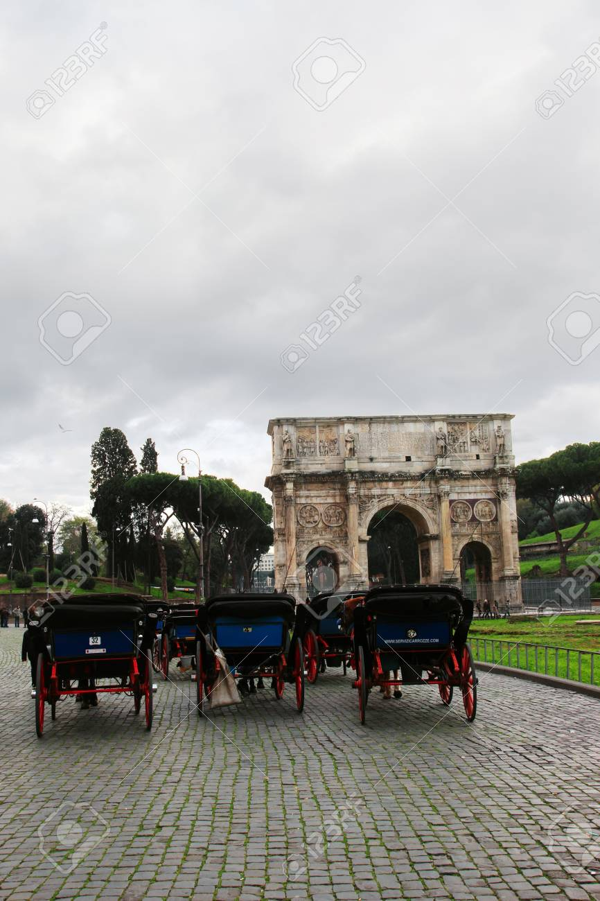 ROME - DEC 7  Carriages await customers at Coliseum entrance with Costantine  Stock Photo - 17069364
