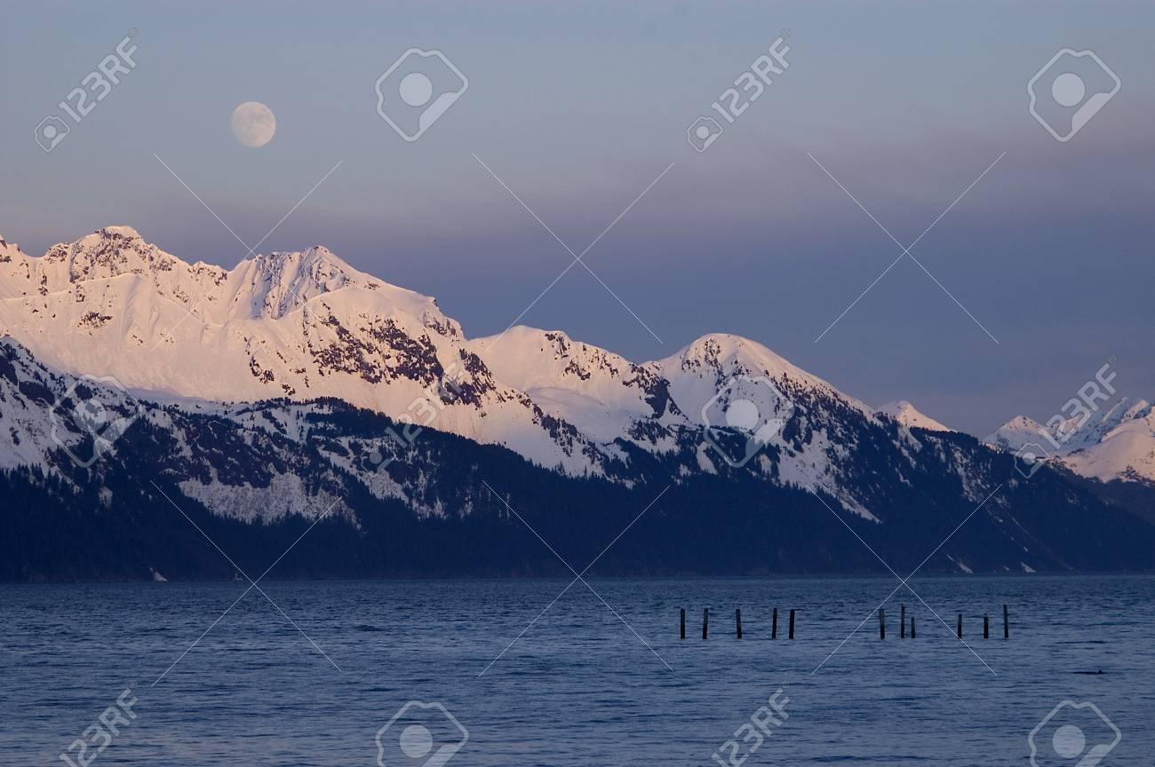 Moonrise over Alaskan Mountain Range Stock Photo - 16460862