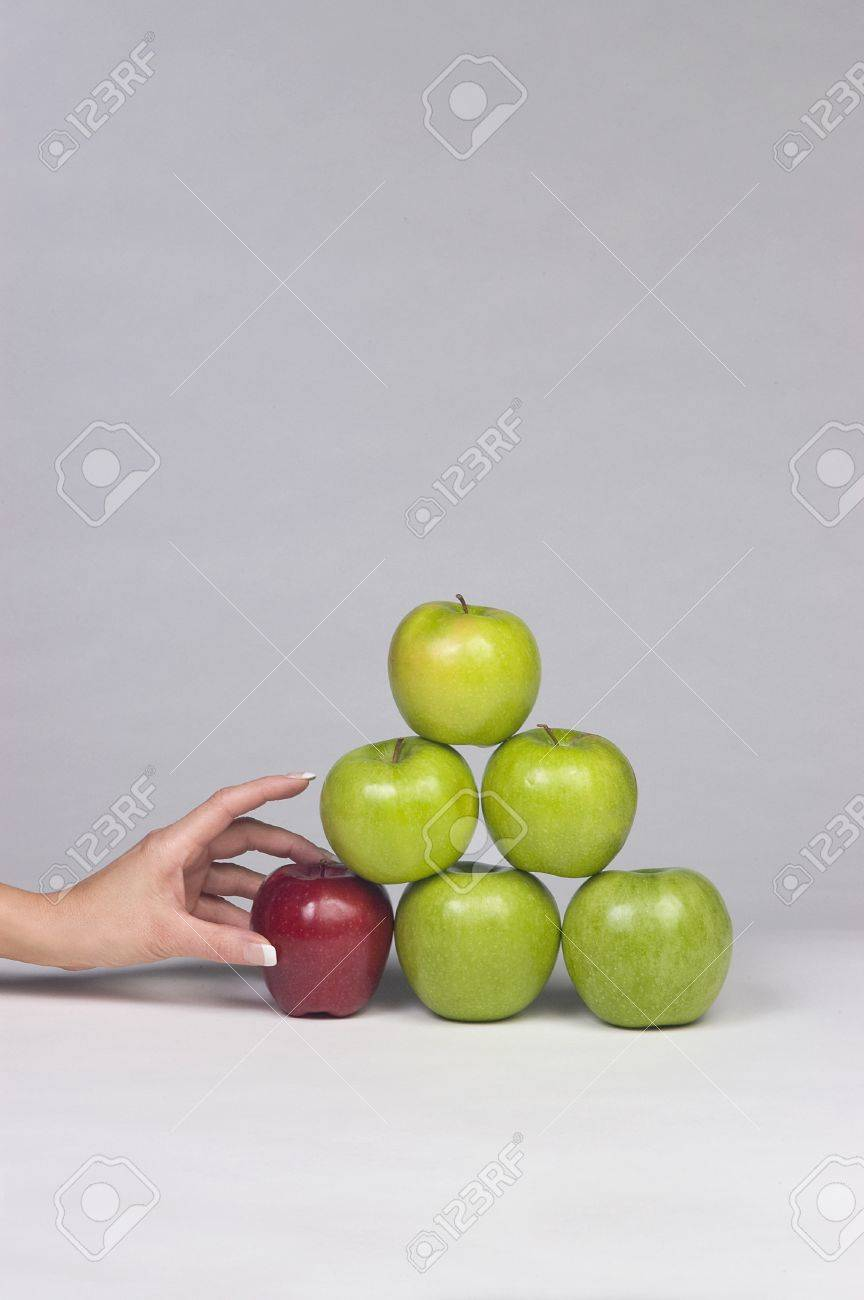 Woman Selecting an dApple from Stack Stock Photo - 17115498