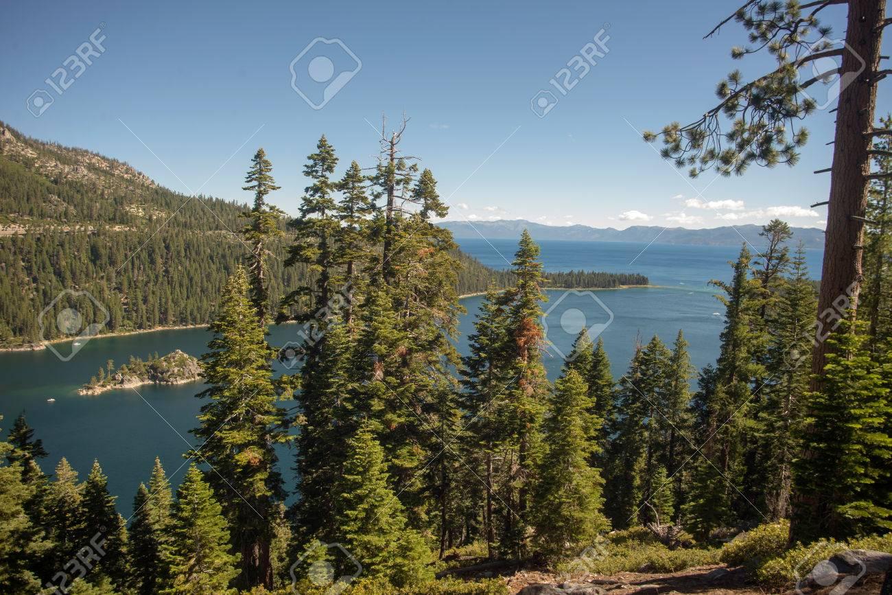 Lake Tahoe through trees Stock Photo - 74449358