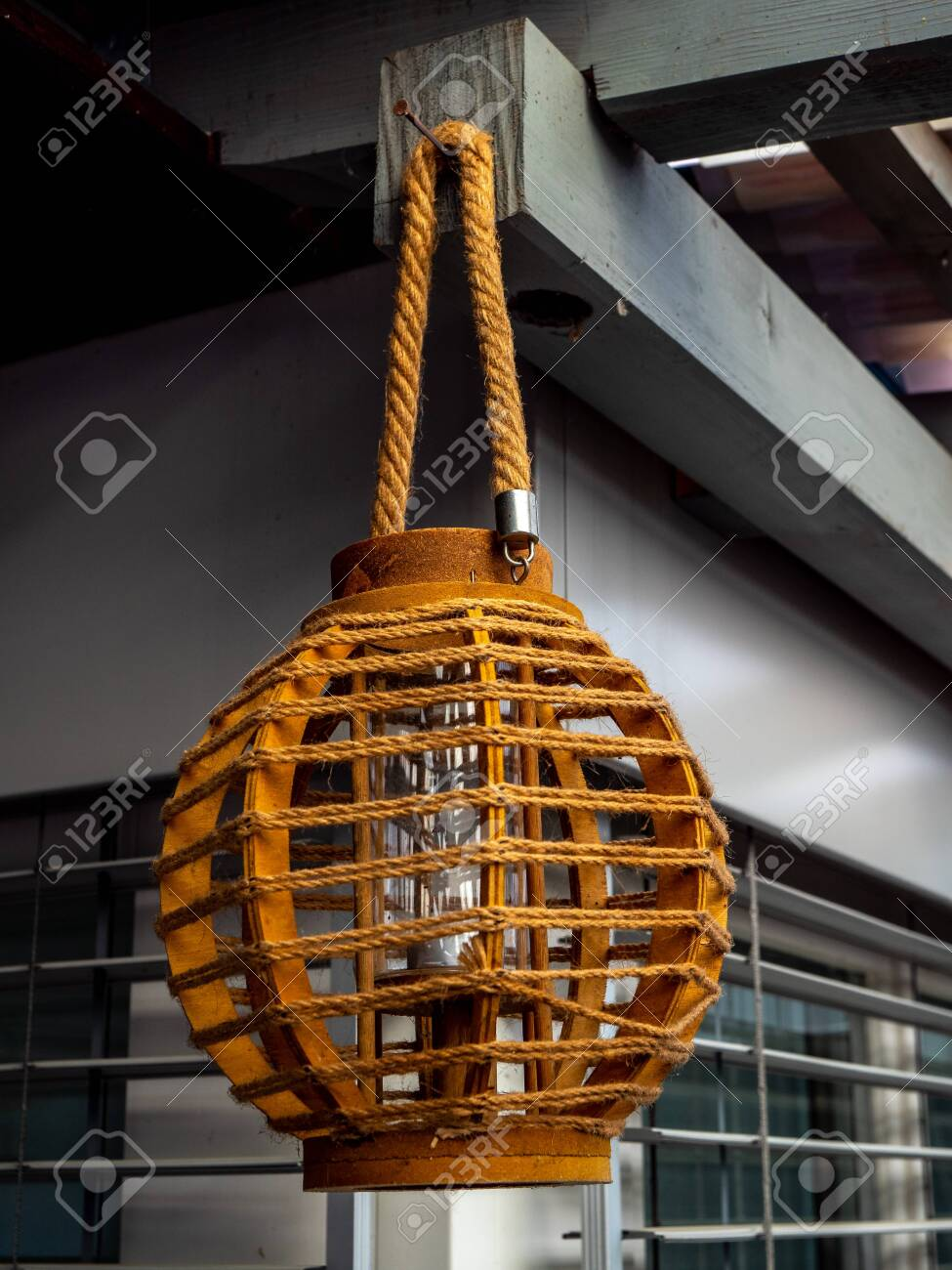 cool outdoor lamp hanging from the roof wood - 120999291