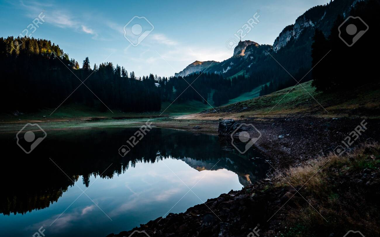 amazing water reflection in clear moutain lake during sunrise morning switzerland alpstein - 120999300