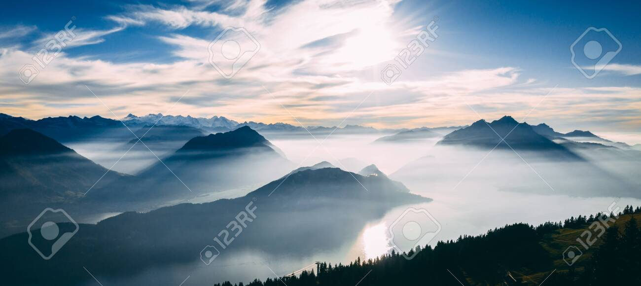 aerial view of mountain scenery in the swiss alps during late autumn, colored pinetrees and blue Lake Lucerne seen from rigi switzerland sunny - 131919999