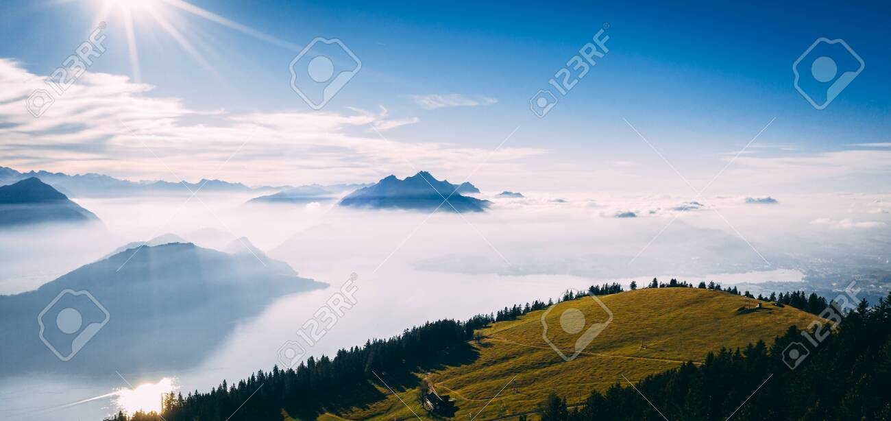 drone view over snow covered mountains during autumn, aerial view over swiss alps with lake in fog covered, rigi switzerland sunny - 131919917
