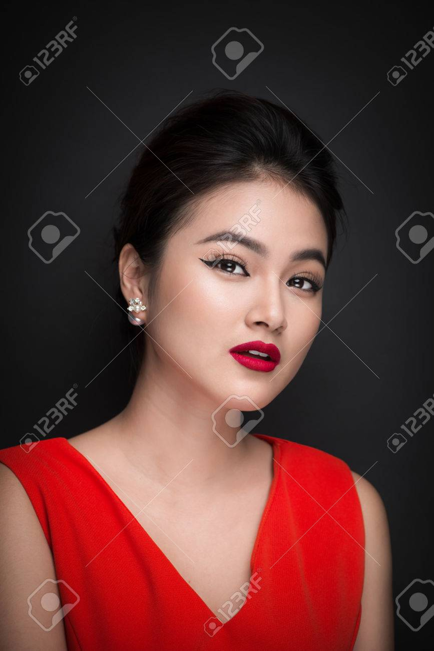 Closeup of beautiful sexy girl with bright makeup and red lips. Beauty fashion asian woman