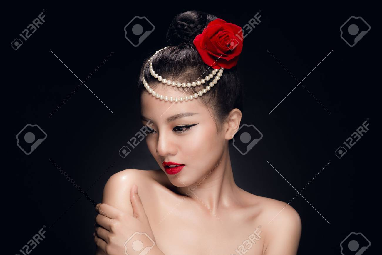 Fashion Studio Shot Of Beautiful Young Asian Woman With Retro