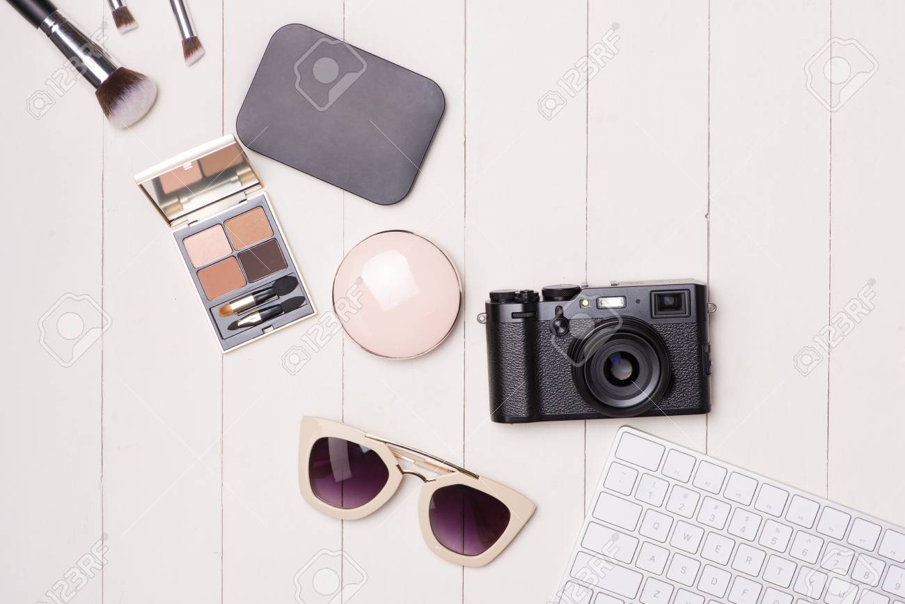 123a29df58f Women cosmetics and fashion items on table with camera and passport...