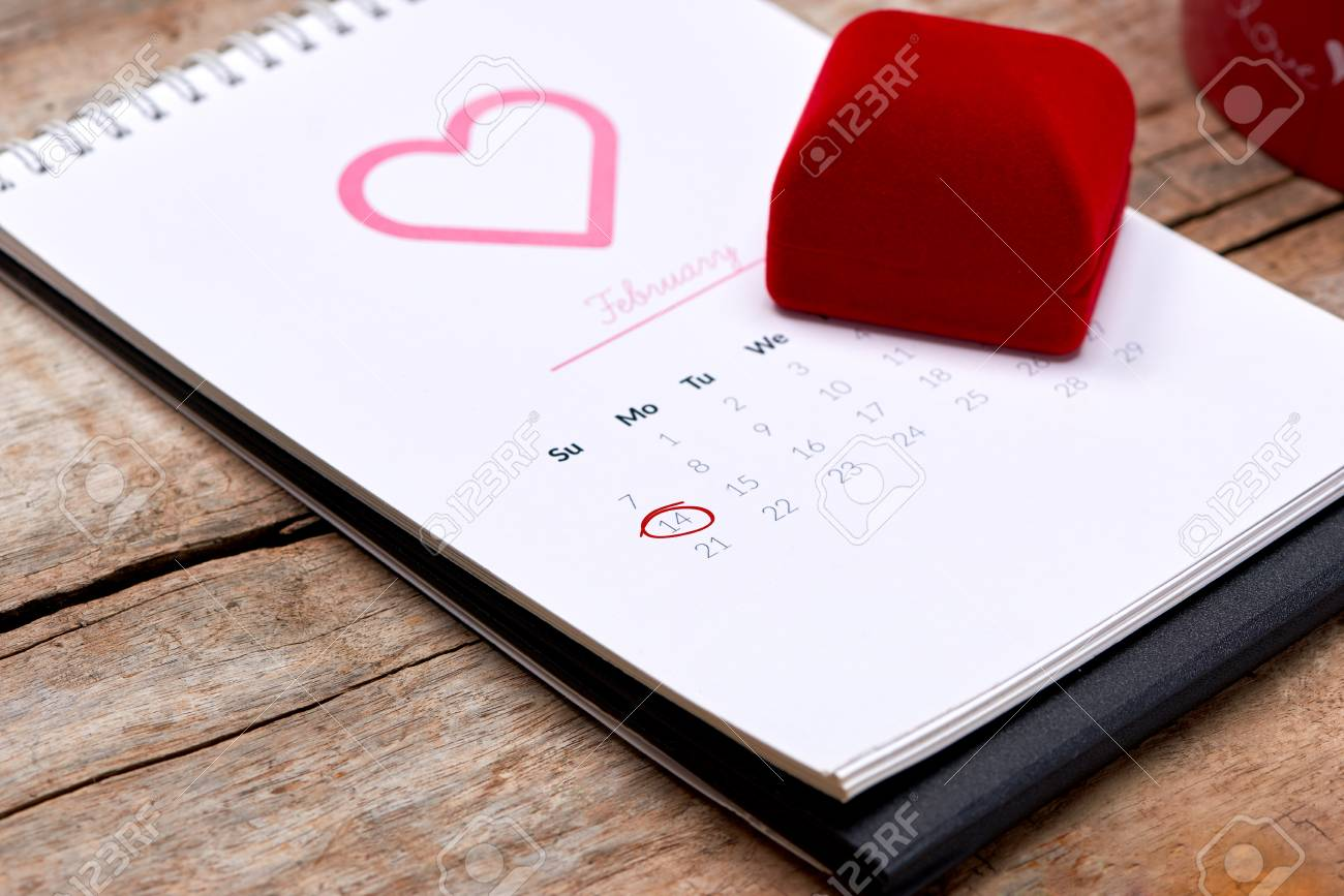 14th of February on calendar date   Red rose, hearts and gift